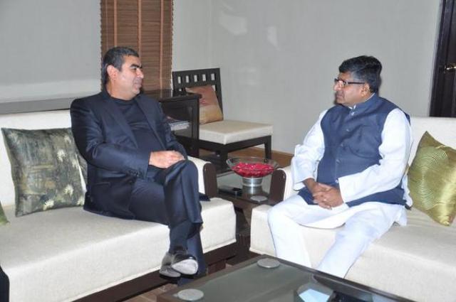 Infosys CEO Vishal Sikka with telecom minister Ravi Shankar Prasad