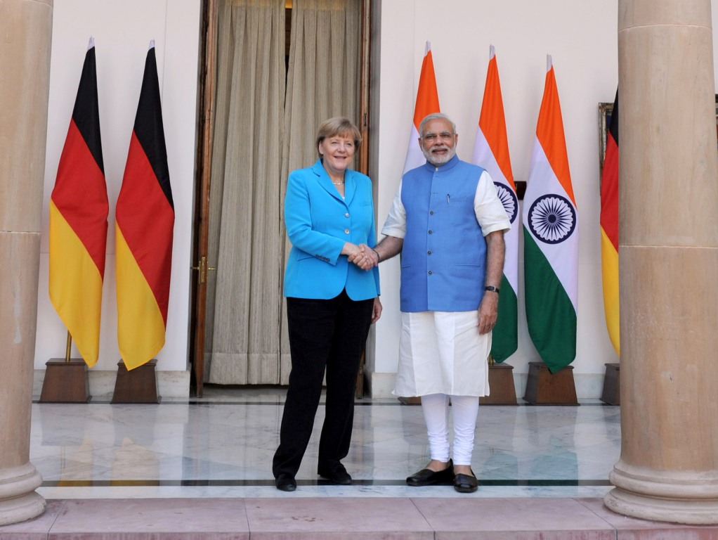 Prime Minister Narendra Modi with German Chancellor Angela Merkel at Hyderabad House, in New Delhi