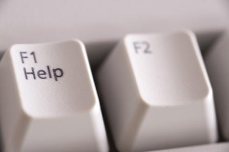 closeup image of the help hey on a computer keyboard